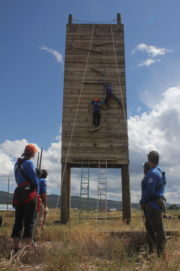People Climbing Ropes Course